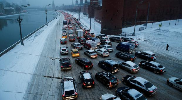 Russia saw a white Christmas as a massive snowstorm in Moscow caused delays to more than 150 flights and brought traffic to a standstill