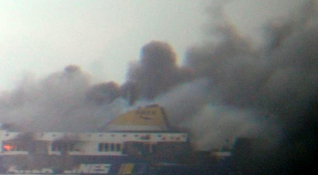 This photo taken from a nearby ship, shows smoke rising from the Italian-flagged Norman Atlantic ferry after it caught fire in the Adriatic Sea. (AP Photo/SKAI TV Station)