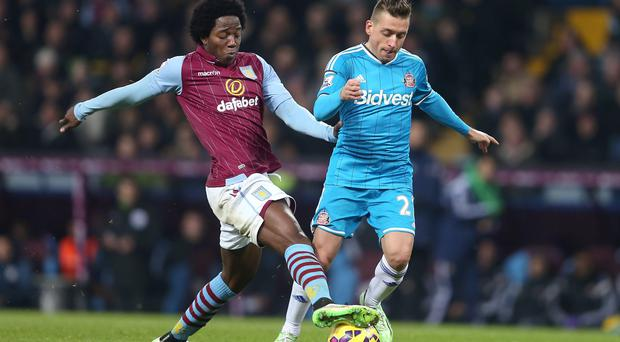 Aston Villa's Carlos Sanchez (left) and Sunderland's Emanuele (right) Giaccherini battle for the ball during the Barclays Premier League match at Villa Park, Birmingham. David Davies/PA Wire.