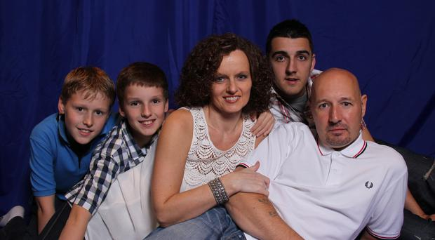 Loving family: Lorraine with late husband Alan and their sons (from left) Nathan, Josh and Matthew