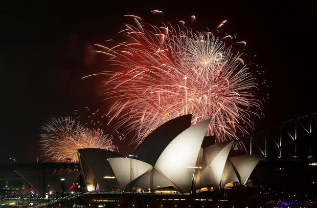 Fireworks expode over the Opera House in Sydney Harbour yesterday marking the arrival of the new year
