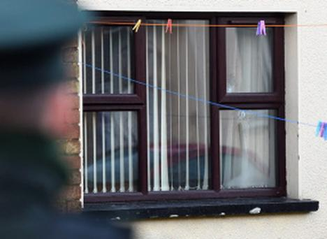 Pacemaker Press 2/1/2015 Police attend the scene of a shooting at McClay Park , Seven adults have escaped injury after A number of shots were fired through the rear window of the house in Omagh Co Tyrone on thursday evening Pic Pacemaker