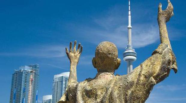 A statue in memorial of Irish Famine emigrants in Toronto; bones that washed up on a Canadian beach are believed to belong to passengers of a sunken Irish famine ship