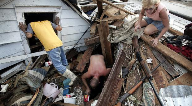 People trying to salvage some of their belongings in aftermath of storm