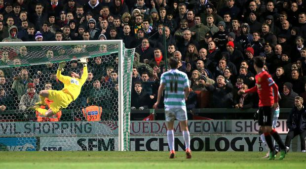 Manchester United's Ander Herrera scores his side's first goal of the game during the FA Cup, Third Round match at Huish Park, Yeovil. Nick Potts/PA Wire.