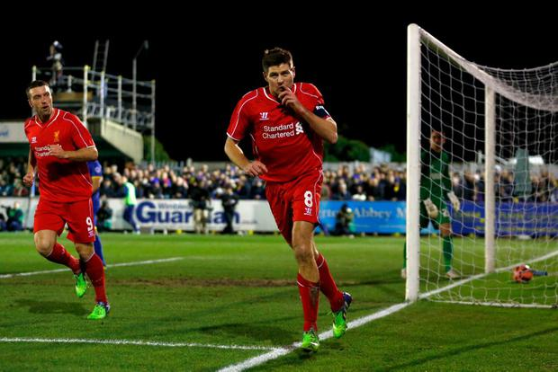 Steven Gerrard of Liverpool celebrates after scoring the opening goal with a header during the FA Cup Third Round match between AFC Wimbledon and Liverpool at The Cherry Red Records Stadium on January 5, 2015 in Kingston upon Thames, England. (Photo by Julian Finney/Getty Images)