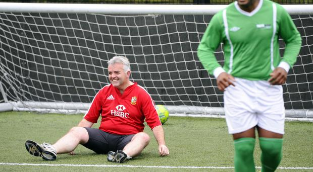 Net gain: the DUP's Jonathan Bell fails to prevent a shot from a World United player in an anti-racism match at Stormont