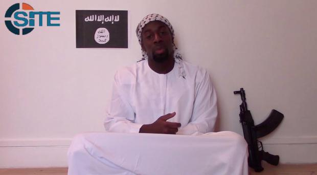 Undated handout still from a video released by the Islamic State (IS) of Paris gunman Amedy Coulibaly pledging allegiance to its leader, Abu Bakr al-Baghdadi, and explaining the motivation for his attack, and also displaying his weapons. IS/PA Wire.