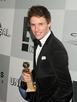 Eddie Redmayne with his Golden Globe for best actor in a film drama in The Theory of Everying (Photo by Jesse Grant/Getty Images for NBCUniversal)