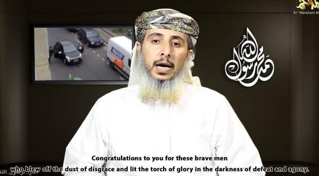 A top Al- Qaeda commander appeared in an 11-minute video posted Wednesday, saying that the massacre at Charlie Hebdo was in