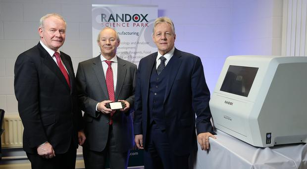 First Minister Peter Robinson and deputy First Minister Martin McGuinness with managing director of Randox, Dr Peter Fitzgerald, after announcing that the global diagnostics is to create 540 quality jobs over four years