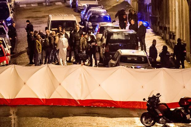 Police officers at the scene of shoot-out in a street in Verviers, Belgium, yesterday