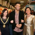 Celebrity Jake Quickenden is escorted around the Belfast Telegraph Holiday World Show by Lord Mayor Nicola Mallon and show organiser Maureen Ledwith after Jake oficially opened the show wich runs until Sunday 18th.