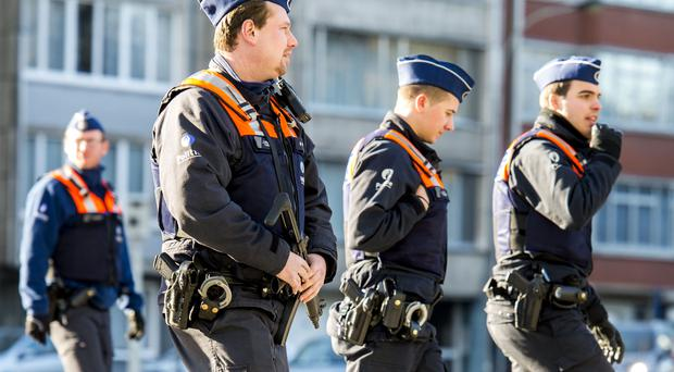 Belgian police officers patrol the Jewish quarter in Antwerp the day after two terror suspects were killed in a shoot-out with police