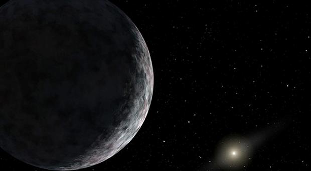 An artist's impression of one of the two as-yet undiscovered planets as big as Earth or larger may be hiding in the outer fringes of the Solar System, scientists believe. Nasa/JPL-Caltech/PA Wire.