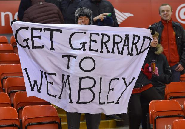 Fans hold up a banner for Captain Steven Gerrard of Liverpool ahead of the Capital One Cup Semi-Final first leg match between Liverpool and Chelsea at Anfield on January 20, 2015 in Liverpool, England. (Photo by Michael Regan/Getty Images)