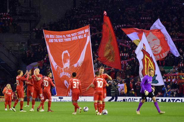 Liverpool prepare to start the game as fans fly a flag for Captain Steven Gerrard (Photo by Michael Regan/Getty Images)
