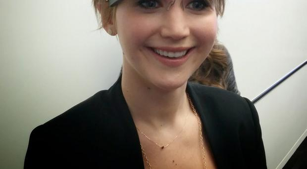 Actress Jennifer Lawrence tries out the Google Glass