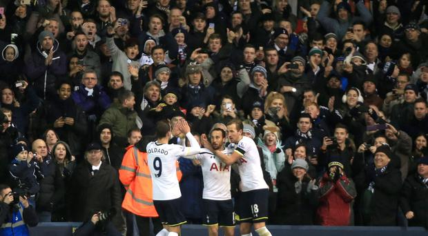Spot on: Andros Townsend celebrates scoring the first goal alongside Harry Kane and Roberto Soldado