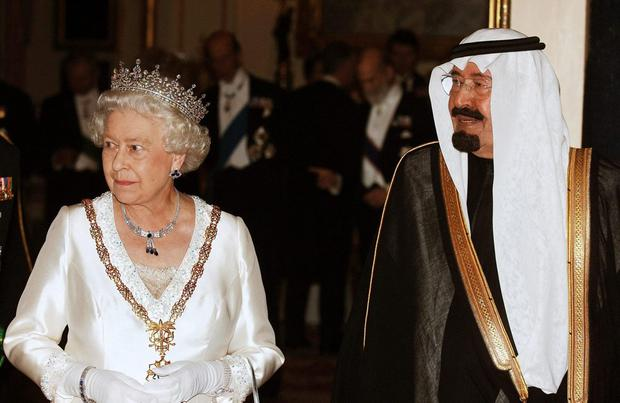 File photo dated 30/10/07 of King Abdullah of Saudi Arabia with Queen Elizabeth II before a State Banquet at Buckingham Palace in London. Photo: PA