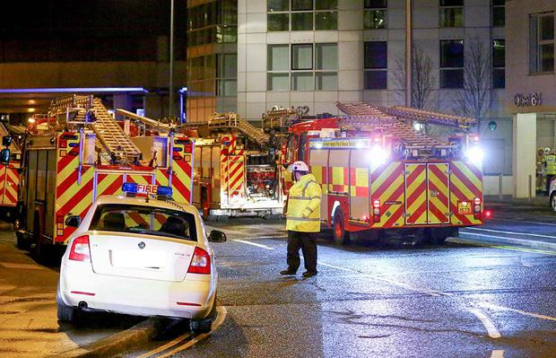 Firefighters at the scene of a fire at the Obel Tower building in Belfast. Photo: Kevin Scott / Presseye