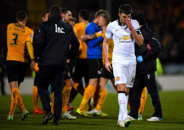 Tough going: Michael Carrick of Manchester United walks off the field after his side failed to break down Cambridge in the FA Cup