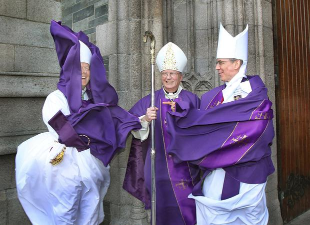 THE HOLY GUST by Margaret McLaughlin - 2nd Prize Daily Life & People. A gust of wind catches the robes of Archbishop Eamon Martin, after the new Bishop of Derry, Donal McKeown, is installed at St Eugenes Cathedral, with Archbishop Charles Brown.
