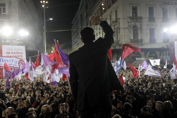 Head of the leftist Syriza party Alexis Tsipras waves to his supporters during a party election rally in central Athens on January 22, 2015 Photo: Getty Images