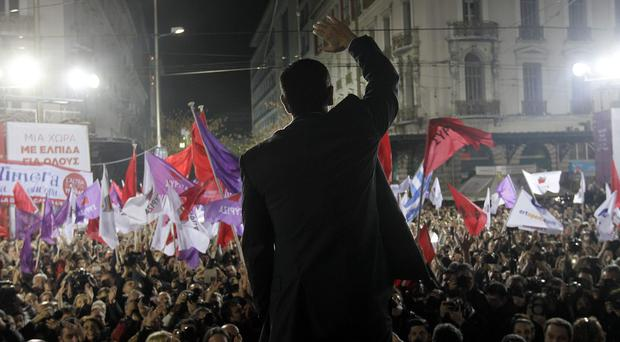 Head of the leftist Syriza party Alexis Tsipras waves to his supporters during a party election rally in central Athens on January 22, 2015, ahead of Greece's general election on January 25. Photo: Getty Images
