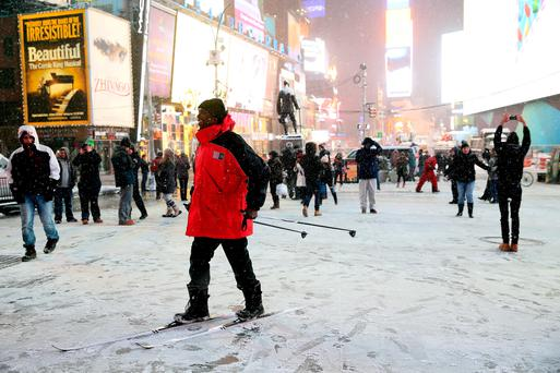 NEW YORK, NY - JANUARY 26: A man stands on skis in Times Square on January 26, 2015 in New York City. New York, and much of the Northeast, is bracing for a major winter storm which is expected to bring blizzard conditions and 10 to 30 inches of snow to the area. (Photo by Alex Trautwig/Getty Images)
