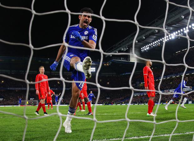 Diego Costa of Chelse celebrates after Branislav Ivanovic of Chelsea scored the opening goal during the Capital One Cup Semi-Final second leg between Chelsea and Liverpool at Stamford Bridge on January 27, 2015 in London, England. (Photo by Julian Finney/Getty Images)