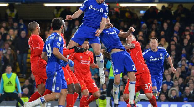 Chelsea's Branislav Ivanovic scores the only goal during last night's League Cup semi-final second leg football match against Liverpool at Stamford Bridge
