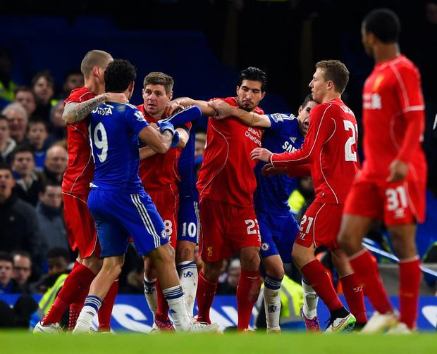 Chelsea's Diego Costa and Liverpool captain Steven Gerrard have to be pulled apart