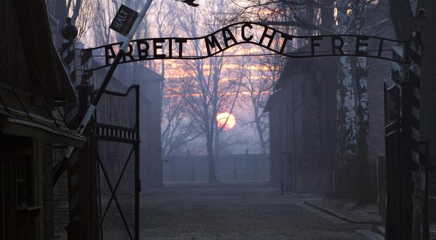 The main gate entering the Nazi Auschwitz death camp