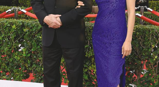 Actor Robert Duvall and his wife Luciana
