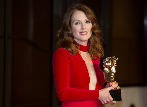 Julianne Moore with her Best Actress Award as she attends the after show party for the EE British Academy Film Awards at the Grosvenor House Hotel in central London. PRESS ASSOCIATION Photo. Picture date: Sunday February 8, 2015. See PA story SHOWBIZ Bafta. Photo credit should read: Daniel Leal-Olivas/PA Wire
