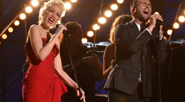 Gwen Stefani, left, and Adam Levine perform at the 57th annual Grammy Awards on Sunday, Feb. 8, 2015, in Los Angeles. (Photo by John Shearer/Invision/AP)