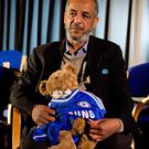 Abase Hussen, father of Amira Abase, 15, holds a bear that Amira gave her mother while being interviewed by the media at New Scotland Yard, central London, as the relatives of three missing schoolgirls believed to have fled to Syria to join Islamic State have pleaded for them to return home. Laura Lean/PA Wire.