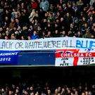 Chelsea fans hold a banner against rascism during a Barclays Premier League match at Stamford Bridge, London. Nick Potts/PA Wire.