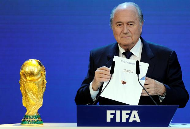 FIFA President Sepp Blatter holding up the name of Qatar during the official announcement of the 2022 World Cup
