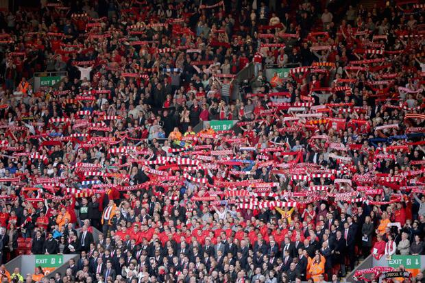 Liverpool fans sing and the Liverpool FC team sing 'You'll Never Walk Alone' during the Hillsborough memorial service marking the 25th anniversary of the Hillsborough Disaster at Anfield stadium on April 15, 2014.