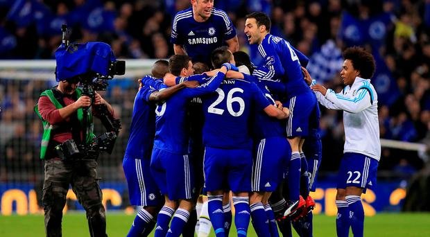Chelsea players celebrate after the game during the Capital One Cup final at Wembley, London. John Walton/PA Wire.