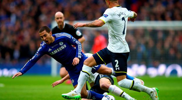 Taking a tumble: Chelsea's Eden Hazard is felled by a combination of Tottenham duo Nabil Bentaleb and Kyle Walker