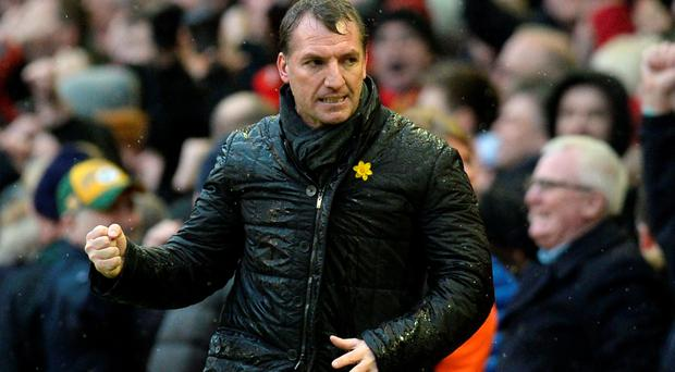 Liverpool's Northern Irish manager Brendan Rodgers celebrates at the final whistle