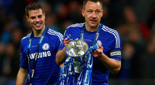 Cesar Azpilicueta and John Terry of Chelsea celebrate