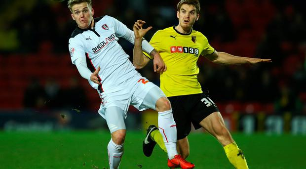 Danny Ward of Rotherham United battles for the ball with Tommie Hoban of Watford