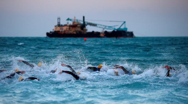 UNITED ARAB EMIRATES, DUBAI - FEBRUARY 27: The Pro men begin the swim leg of the race during the Challenge Triathlon Dubai on 27 February, 2015 in Dubai, United Arab Emirates. (Photo by Charlie Crowhurst/Getty Images for Challenge Triathlon)