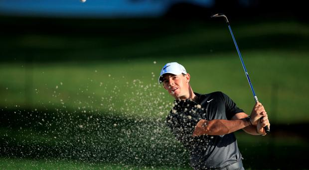 Ready to roar: Rory McIlroy practices yesterday ahead of the WGC-Cadillac Championship in Florida