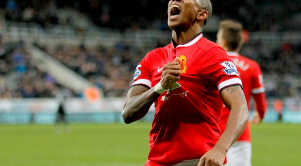 Better late than never: Ashley Young salutes the fans after his late winner for United