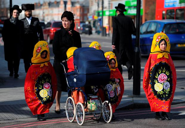 Orthodox Jewish children celebrate the festival of Purim in Stamford Hill in north London on Thursday March 5, 2015. Photo: Lauren Hurley/PA Wire